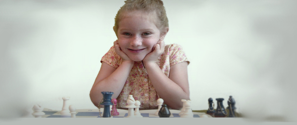 Girl happy with chess game
